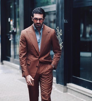How to wear: brown sunglasses, light blue long sleeve shirt, brown suit