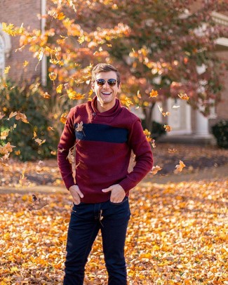 How to wear: brown sunglasses, navy jeans, burgundy shawl-neck sweater