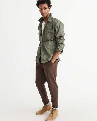 How to wear: tan suede desert boots, brown sweatpants, white crew-neck t-shirt, olive military jacket