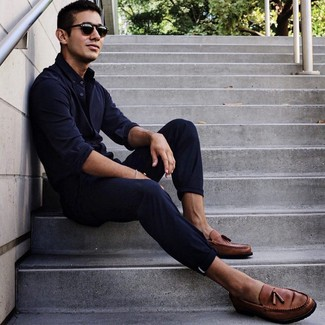 How to wear: black sunglasses, brown leather tassel loafers, navy chinos, navy long sleeve shirt