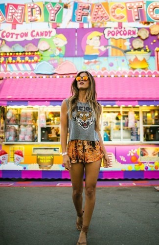 How to wear: orange sunglasses, brown leather thong sandals, orange print shorts, grey print cropped top