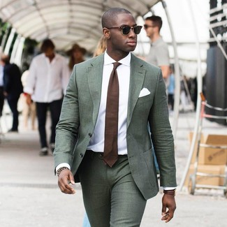 How to wear: white pocket square, brown tie, white dress shirt, dark green suit