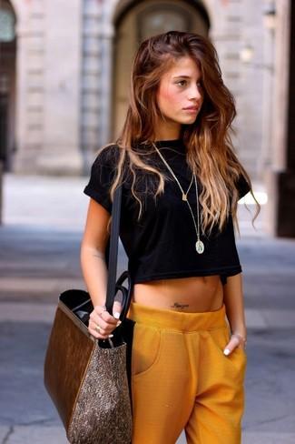 How to wear: silver pendant, brown suede tote bag, orange pajama pants, black cropped top