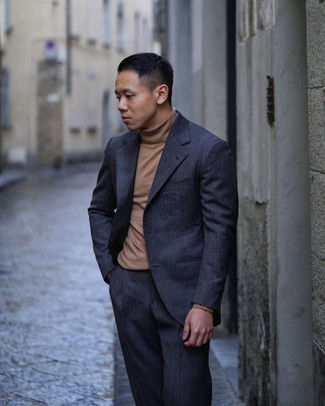How to wear: brown turtleneck, navy vertical striped suit