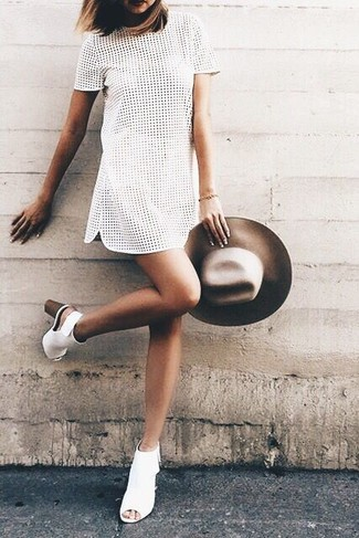 How to wear: brown wool hat, white cutout leather ankle boots, white eyelet shift dress