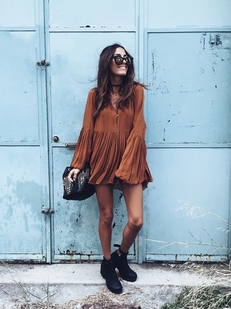 How to wear: black and gold sunglasses, black embellished leather bucket bag, black leather ankle boots, tobacco swing dress