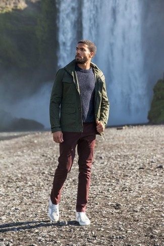 How to wear: white leather low top sneakers, burgundy chinos, navy crew-neck sweater, olive military jacket