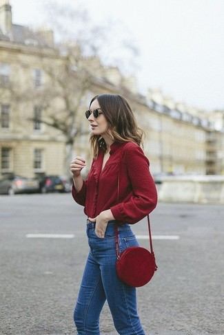 How to wear: black sunglasses, burgundy leather crossbody bag, blue jeans, burgundy long sleeve blouse