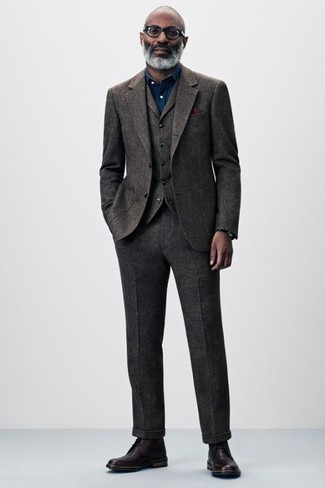How to wear: burgundy pocket square, burgundy leather dress boots, navy chambray dress shirt, dark brown wool three piece suit