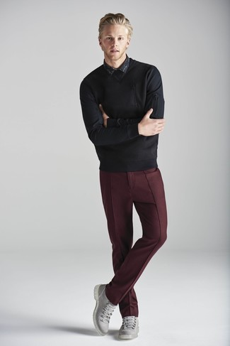 How to wear: grey leather casual boots, burgundy dress pants, black print long sleeve shirt, black crew-neck sweater