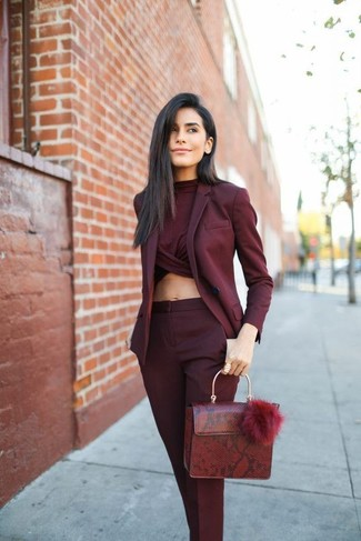 How to wear: burgundy leather satchel bag, burgundy dress pants, burgundy cropped top, burgundy blazer