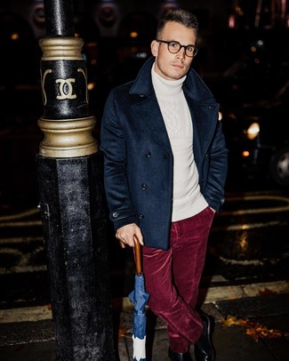 How to wear: black leather chelsea boots, burgundy velvet dress pants, white knit wool turtleneck, navy pea coat