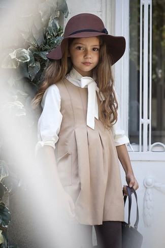 How to Wear a White Long Sleeve T-Shirt For Girls: Consider dressing your girl in a white long sleeve t-shirt with beige dress for a glam and trendy getup.