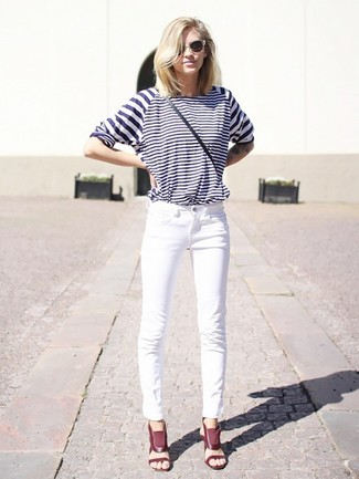 How to wear: black leather crossbody bag, burgundy leather heeled sandals, white jeans, white and navy horizontal striped long sleeve t-shirt