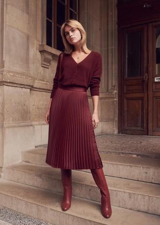 How to wear: burgundy leather crossbody bag, burgundy leather knee high boots, burgundy pleated midi skirt, burgundy cardigan