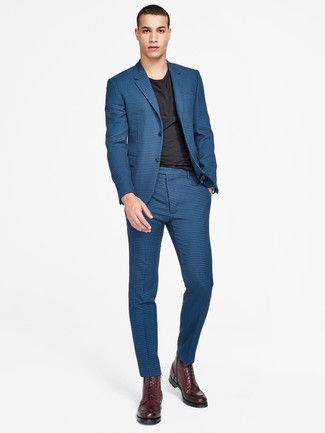 How to Wear Burgundy Leather Casual Boots For Men: The formula for a neat and casually classic ensemble? A blue check suit with a black crew-neck t-shirt. Look at how well this look goes with a pair of burgundy leather casual boots.