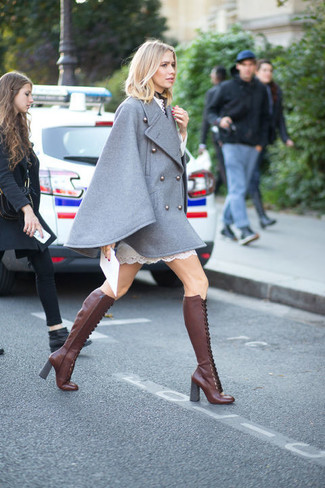 How to Wear Burgundy Leather Knee High Boots: For an outfit that's super simple but can be smartened up or dressed down in a variety of different ways, wear a grey cape coat and a white lace shift dress. Our favorite of a myriad of ways to complete this ensemble is with burgundy leather knee high boots.