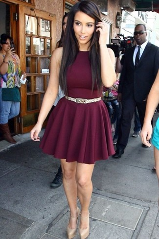 Kim Kardashian wearing Burgundy Skater Dress, Gold Leather Pumps, Gold Belt