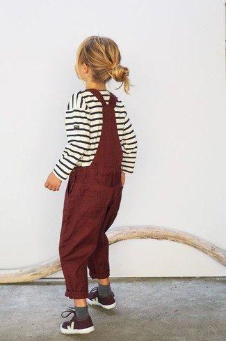 How to wear: grey socks, burgundy sneakers, burgundy overalls, white horizontal striped sweater