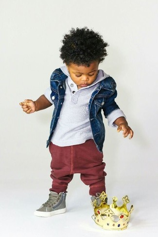 How to Wear a Denim Jacket For Boys: Suggest that your little man team a denim jacket with burgundy sweatpants for a fun day in the park. This style is complemented brilliantly with olive sneakers.