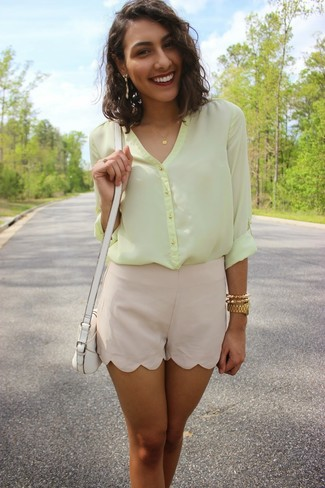 Dress to impress in a yellow chiffon button down blouse and jewelry. This combination is basically a lesson in how to master the summer fashion.