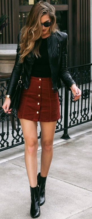 How to wear: black leather ankle boots, red suede button skirt, black crew-neck t-shirt, black leather bomber jacket