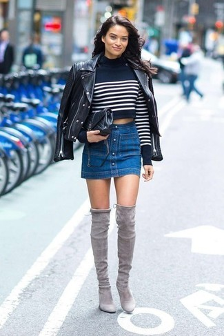 How to wear: grey suede over the knee boots, blue denim button skirt, navy and white horizontal striped cropped sweater, black leather biker jacket