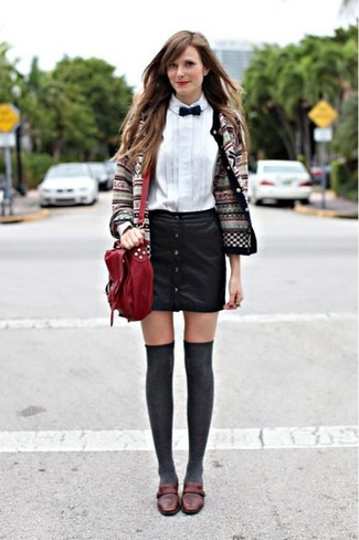 How to wear: dark brown leather loafers, black leather button skirt, white dress shirt, grey fair isle cardigan