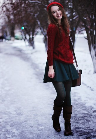 A red knit jumper and a teal skater skirt are great essentials to incorporate into your current wardrobe. Add dark brown leather knee high boots to your getup for an instant style upgrade. When it comes to dressing for weird fall weather, nothing beats a knockout combo that will keep you warm and looking your best.