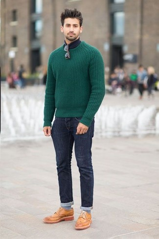 This combo of a dark green cable sweater and dark blue jeans spells comfort and cool. Why not introduce camel leather brogues to the equation for an added touch of style? This combo is perfect for unpredictable fall weather.