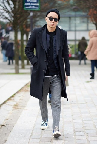 How to Wear a Black Overcoat: Pair a black overcoat with grey wool chinos to assemble an interesting and well-executed outfit. Blue canvas low top sneakers are a fail-safe way to bring a hint of stylish casualness to this outfit.
