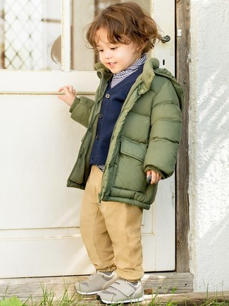 Boys' Looks & Outfits: What To Wear In Cold Weather: Dress your little man in an olive puffer jacket and tan trousers for a comfortable outfit that's also put together nicely. This outfit is complemented really well with grey sneakers.