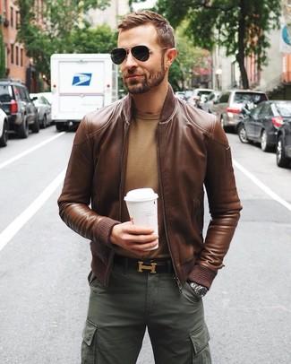 How to wear: dark brown leather belt, dark green cargo pants, tan crew-neck sweater, brown leather bomber jacket