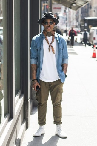 How to Wear a Light Blue Denim Shirt For Men: Why not team a light blue denim shirt with olive cargo pants? These items are super comfortable and look amazing when combined together. Why not complete your getup with white canvas high top sneakers for a mellow vibe?