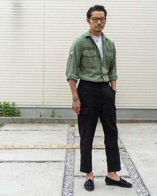 How to Wear Black Suede Tassel Loafers: This combo of an olive long sleeve shirt and black cargo pants spells comfort and style. Feeling venturesome? Shake up your getup by wearing black suede tassel loafers.
