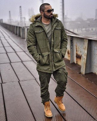 How to wear: tobacco suede work boots, olive cargo pants, olive crew-neck t-shirt, olive parka