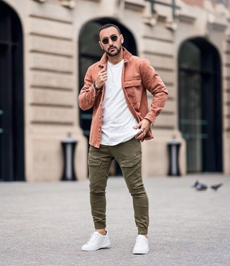 How to wear: white leather low top sneakers, olive cargo pants, white crew-neck t-shirt, pink shirt jacket
