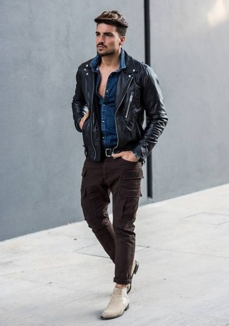How to wear: beige suede chelsea boots, dark brown cargo pants, navy denim shirt, black leather biker jacket