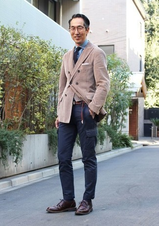 How to Wear a Light Blue Dress Shirt For Men: For an ensemble that's pared-down but can be dressed up or down in a variety of different ways, consider pairing a light blue dress shirt with navy cargo pants. If you want to immediately lift up this look with a pair of shoes, why not complete this look with a pair of burgundy leather derby shoes?