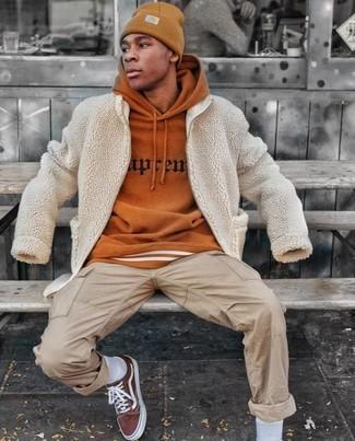 How to wear: brown canvas low top sneakers, beige cargo pants, tobacco print hoodie, beige textured bomber jacket