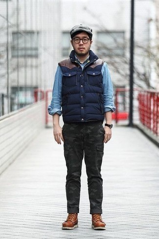 How to Wear Brown Leather Casual Boots For Men: You'll be surprised at how easy it is for any gent to get dressed this way. Just a navy quilted gilet and charcoal camouflage cargo pants. For a dressier twist, add a pair of brown leather casual boots to the mix.