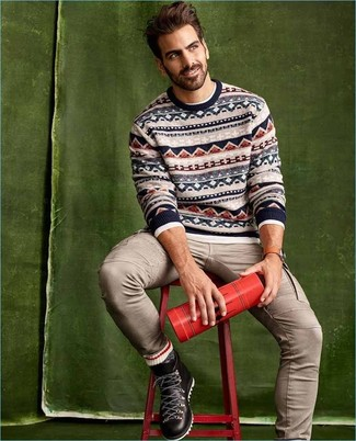 How to wear: black leather work boots, beige cargo pants, white long sleeve t-shirt, beige fair isle crew-neck sweater