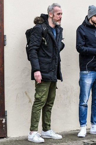 How to wear: white leather low top sneakers, olive cargo pants, blue sweatshirt, black parka
