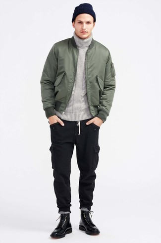 How to wear: black leather casual boots, black cargo pants, grey knit turtleneck, olive bomber jacket