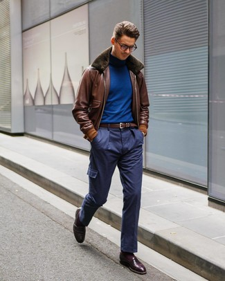 How to wear: burgundy leather loafers, navy cargo pants, blue turtleneck, brown leather bomber jacket