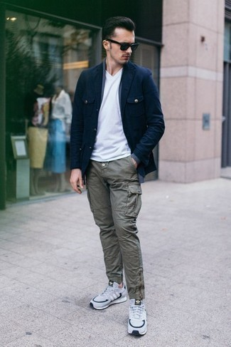 How to Wear a White V-neck T-shirt For Men: For a casually dapper outfit, marry a white v-neck t-shirt with olive cargo pants — these pieces go pretty good together. Feel somewhat uninspired with this ensemble? Invite white and navy athletic shoes to change things up a bit.