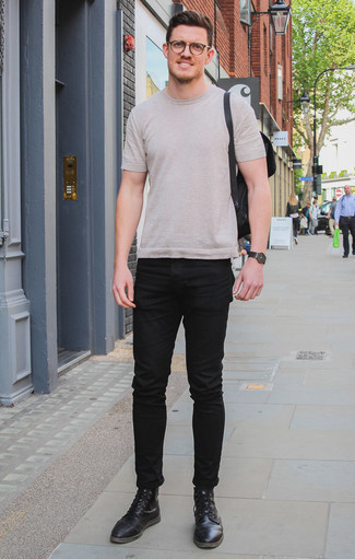 How to Wear Black Jeans For Men: Reach for a beige crew-neck t-shirt and black jeans for an everyday getup that's full of style and character. Black leather casual boots will easily elevate even your most comfortable clothes.