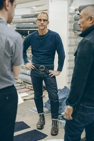 How to Wear Boots For Men: A navy sweatshirt and navy jeans make for the perfect foundation for a variety of combinations. Finishing with a pair of boots is an effective way to bring a dose of refinement to this outfit.
