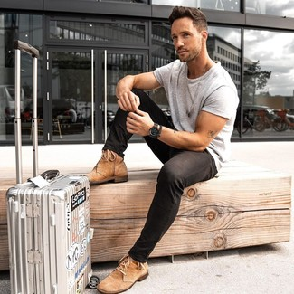How to wear: silver suitcase, tan suede casual boots, black skinny jeans, grey crew-neck t-shirt