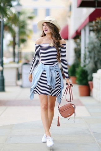 How to wear: white and navy horizontal striped casual dress, light blue denim shirt, white low top sneakers, brown leather crossbody bag